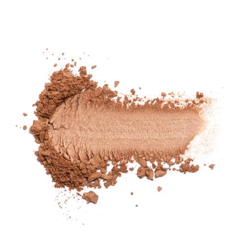 A crumbled smudge of medium matte bronze powder on a white background.