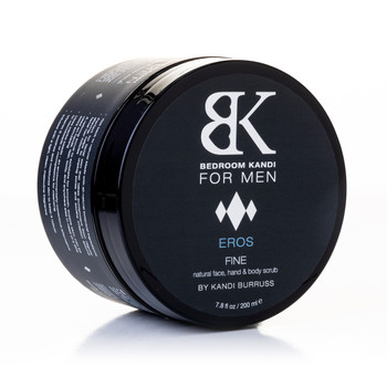 An image of a round black jar of BK for Men's Fine natural face, hand and body scrub, balanced on its side on a white background.