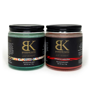 "Two 4oz jars of Just Dessert edible body paint sit together. The left has green contents and is labeled ""sugar cookie"", the right has red contents and is labeled ""cinnamon swirl"""