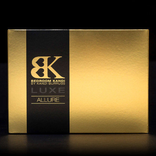 An image of the black and gold Luxe Allure packaging sitting on a black background.