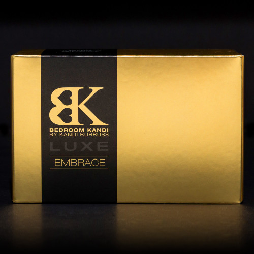 An image of the luxurious gold and black box that Embrace comes packaged in, sitting on a black background.