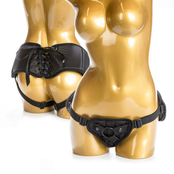 An image of two golden mannequins on a white background wearing the black match-maker harness, visible from the front and the back.