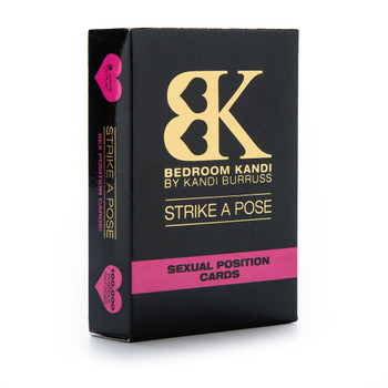An upright box of Bedroom Kandi's Strike A Pose sex position cards deck. The box is black with gold and pink accents, and stands on a white background.