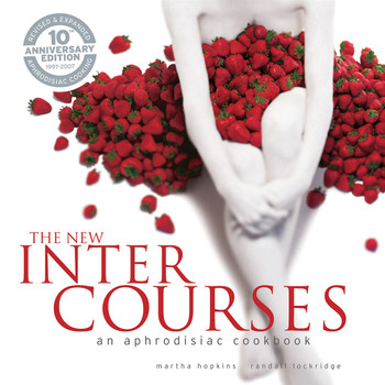 An image of the cover of The New Intercourses aphrodisiac cookbook. The cover art features a sensual photo of a pale woman covered in a pile of strawberries.