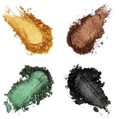 """Four converging crumbled smudges of powdered eye shadow in a warm yellow-gold, a deep brown bronze, a dark gray with gold flecks, and a sheer jade green. These belong to """"Safari."""""""
