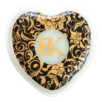 An image of a plastic heart-shaped flat sealed pouch printed with black and gold. Inside is a gelatinous material.