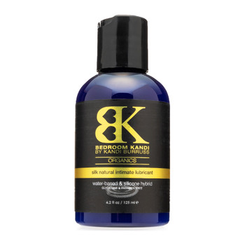 An image of Bedroom Kandi's SILK hybrid lubricant in a dark blue bottle with a black cap on a white background.